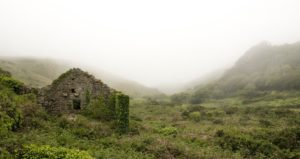 An abandoned house in a valley